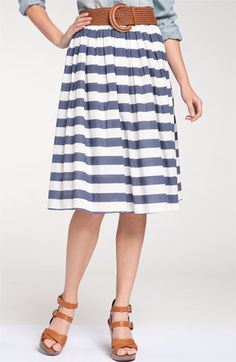 Remain Belted Stripe Midi Skirt   Be the first to write a review  | discuss this item  Jaunty stripes and a wide woven belt accent a midi-length skirt cut with a swingy, full silhouette.  Removable belt.  Lined.  Cotton; hand wash.  By Remain; imported.  t.b.d.  item #510298  $78.00