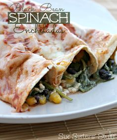 Black Bean Spinach Enchiladas from Six Sisters' Stuff, is a dinner your whole family will love!