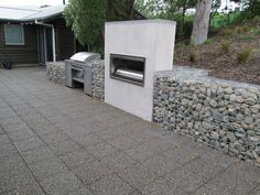 Decorative Gabions / Stones / Rock Walls: Gabion retaining wall fire place