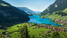 Town and Lake Lungern (Lungerersee) view from Bruenigpass, Obwalden, Switzerland, 9ece008ee92b2050527139ab793ee4b4