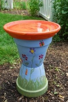 Macie Beth's birdbath for her lit'l playhouse...a few tweaks and I think she'll love it. Made with terra cotta pots, a bowl, paint and lots of love.