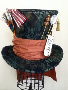 Tim Burton's Mad Hatter Top Hat. $130.00, via Etsy. Now as much as I love Tim Burton... I seriously do not think I would pay $ 130.00 for The Mad Hatter's Hat. That would take me like FOREVER to save up for it!!