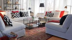 Treat yourself to a classy white, black and orange get together in the living room.  Arrange seating to face in for the perfect conversation area!