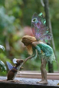 Is that a real person? If so, that's a really big mouse. I really like the faerie wings. What could it be?