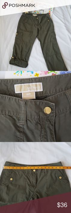 Michael Kors olive green convertible pants sz 8 Mk convertible cargo pants, olive green in sz 8. Excellent condition.  Please refer to the photos for the flat lay measurements. Please do not forget to look over my other posh listings in the closet. Happy Poshing! ♥️🌸😊🎶 Michael Kors Pants