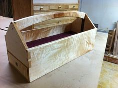By Matthew Allard A real fancy tool tote for your diy projects. Made from figured maple.