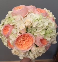 A stunning bridal bouquet with David Austin 'Juliet' roses, white hydrangeas, white roses and cream carnations
