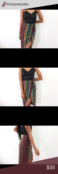 The Visionary- Flap Skirt Details: Fitted flap skirt. Woven tribal patterning .Black trim. Unlined. Back zip and hook closure. Flap design allows for wide hem slit. Waist: 37.5 Hips: 37.5 Full Garment Length: 29.5 Marked size: UK 10 EU 38 US 6 Color: Yellow, green, burgundy, brown, black, grey, navy blue Fabric: 87% Cotton 13 % Polyester Condition/Care: Excellent/ Machine Wash ASOS Skirts Midi