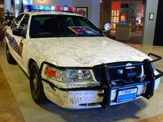 Two of the cars on display are memorials to the officers who drove them, and were killed in the line of duty. One car, which was driven by Fort Worth, Texas police officer Henry Nava, is covered with handwritten messages from the people of Fort Worth and his fellow officers, as a tribute to the veteran officer, who was killed while trying to arrest a suspect on a parole violation in November, 2005. (The American Police Hall of Fame & Museum)