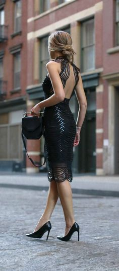 Cocktail Attire - What to wear to fall and winter weddings. Black scalloped lace midi cocktail dress with sequins and open back.