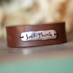 "Wearing this contemporary, leather bracelet, with the sterling silver inscription, Just Think, is a wonderful way of reminding yourself you are fearfully and wonderfully made and that God is working in you, fulfilling the specific purpose He has for you at this time in history. It will certainly spark conversations with others, allowing you to speak blessings of hope and encouragement in their lives. Bracelet fastens by leather loop around a silver extension. 7⅜"" in length. $28"