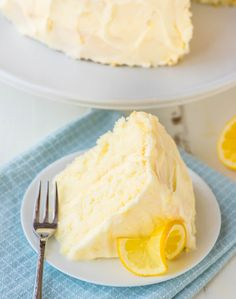 This Lemon Cake Recipe tastes like sunshine on a plate! Moist, fluffy and bursting with bright lemon flavor. Slathered in Lemon Cream Cheese Frosting and so dang good! @wellplated