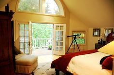 This Aspen home features a cozy and warm bedroom with an amazing view of Aspen Mountain.