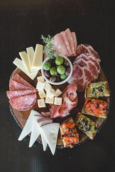 Nice Italian antipasto style meat and cheese tray, bruschetta toasts on the side.