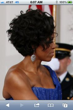Side view of Michelle O's curly bob