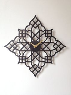 Gorgeous laser cut wood clock - With a black time hand.