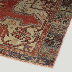 Handpicked for its exquisite Anatolian artwork, this genuine vintage rug is rich in character and full of old world charm. Hand-knotted in the mid-20th century by a master weaver, it features a complex geometric medallion in soft blue popping from a faded red field. <b>This item is final sale. Final sale items cannot be returned, refunded or exchanged.</b>