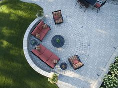 A Roman Circle patio makes for an impressive backyard setting. Picnic Blanket, Outdoor Blanket, Precast Concrete, Roman, Landscaping, Backyard, Outdoors, Entertaining, Courtyards