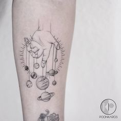 Planet puppet tattoo on the left inner forearm. Tattoo artist:...
