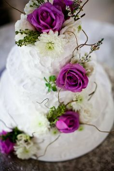 This very beautiful cake carries the purple theme right through the wedding