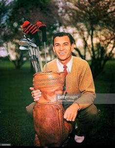 Ben Hogan poses with his golf bag during a 1940s Masters Tournament at Augusta National Golf Club in April of the 1940s in Augusta, Georgia.