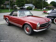1967 Mercedes Benz 230 SL. I WANT TO DRIVE THAT.