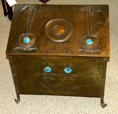 copper coal scuttle with Ruskin tiles