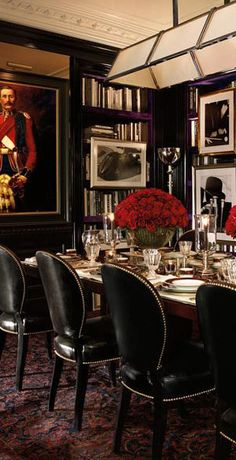 Love black and white accented with splashes of rich colour, a la this Ralph Lauren Dining Room.