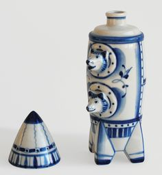 The Stray Dogs That Became Soviet Space Heroes | These two dogs appeared on a huge range of products and memorabilia as well, including postcards, buttons, and this ceramic flask. They received fan mail from around the world, which was answered by the scientists who took care of them. When they died, their bodies were stuffed. Today they are on display at the Memorial Museum of Cosmonautics in Moscow.  FUEL Publishing/Marianne Can den Lemmer  | WIRED.com