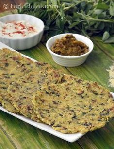 Health and taste come together in this lovely roti. A bouquet of wholesome ingredients such as grated cauliflower and potatoes, methi leaves and coriander go into the maize flour dough used to make this roti. Serve immediately with curds and pickle, or a subzi of your choice.