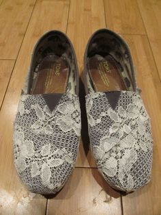 TOMS <3 - I might try to do this to Shannon's old Tom's and cover up her 'toe' hole by placing the lace just right.