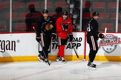 Antoine Vermette, Patrick Kane and Patrick Sharp smile after scoring a goal at Wednesday's practice. #Blackhawks