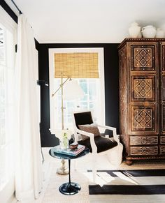 Reading nook in living room with wood cabinet