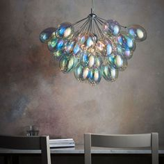 Charming and unusual balloons-style chandelier with reflective glass shades concealing six lights