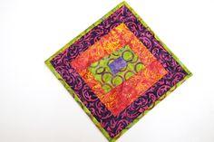 Batik Patchwork Mini Quilt or Mug Rug in Bright and Colorful Batik Fabrics by MyBitOfWonder on Etsy https://www.etsy.com/listing/517136378/batik-patchwork-mini-quilt-or-mug-rug-in
