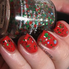 KBShimmer Winter 2014 Kringle All the Way is a clear based glitter topper filled with circle glitters in green, red, silver, and gold. Formula was nice on this one with great glitter payoff. For this mani, I used 2 coats over OPI Coca Cola Red. This is just Christmas in a bottle and it will add instant holiday flair to any creme you layer it over. I think it would look fab over white, red, green, black, silver, gold, or even in a jelly sandwich!