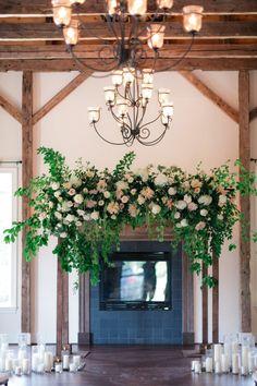 Romantic indoor floral arbor: http://www.stylemepretty.com/virginia-weddings/spotsylvania-virginia/2016/01/07/rustic-elegant-summer-wedding-at-stevenson-ridge/ | Photography: Melissa Arlena - http://www.melissaarlenaphotography.com/