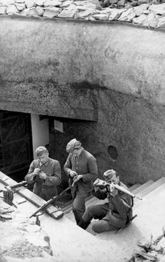 German soldiers clean their rifles in a fortification of the Atlantic Wall (German: Atlantikwall) in German occupied Norway. The Atlantic Wall was an extensive system of coastal fortifications built by Germany between 1942 and 1945 along the western coast of Europe as a defense against an anticipated Allied invasion of the mainland continent from Great Britain. Norway. June 1943.