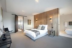 Stunning Master Bedroom Design With Minimalist Interior In Modern Style With Wooden Wall Panel Used Open Bathroom Interior Design Attic Master Bedroom, Master Bedroom Design, Home Bedroom, Modern Bedroom, Master Suite, Block House, Bedroom Layouts, Bathroom Interior Design, Interior Ideas