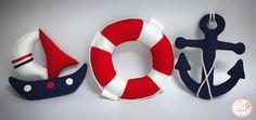 Lindo kit marinheiro. Ótima sugestão para nascimento, chá de bebê, aniversário, decoração, centro de mesa ou como acessório para quadro de maternidade/nicho. Contém 3 peças sendo: 1 âncora, 1 barquinho e 1 bóia. As peças possuem em média o tamanho de 25x25 cm.