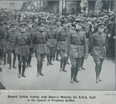 Michael Collins front and centre at the funeral of Arthur Griffiths, with Emmet Dalton in the centre of the picture in the row of officers behind him.