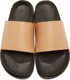 Leather sandals in tan and black. Round open toe. Molded footbed. Tonal stitching.