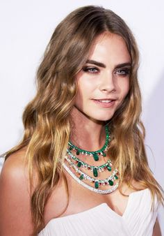 Cara Delevingne's perfectly tousled waves and soft brown eye shadow