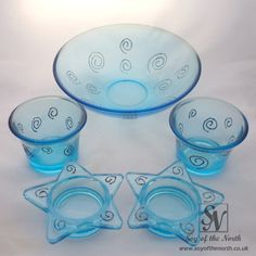 Blue glass, hand decorated candle holders