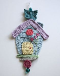Crochet house.  http://sandra-cherryheart.blogspot.com/2011/06/wednesdays-child.html
