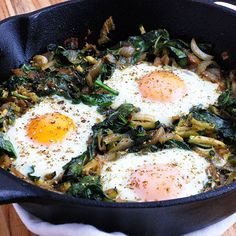 Green Paleo Shakshuka (Good for Any Meal)- This healthy and satisfying dish is a lighter, greener version of traditional shakshuka. It's ideal for any time of the day, whether it's brunch, lunch, or late dinner. Warm eggs are cooked over a garlicky mix of zucchini, spinach, and onions for a flavorful and delicious meal.