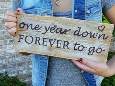 Rustic wedding anniversary photo prop! Perfect for Facebook, Instagram, Mr. & Mrs. dinner photos on the 1st anniversary! https://www.etsy.com/listing/206784589/one-year-down-forever-to-go-wood-sign