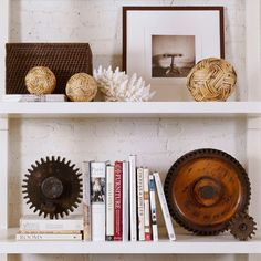 Color and Style. Decor with natural elements can be streamlined and contemporary, as this shelving display shows. Sleek balls made of woven reeds provide a smooth shape to offset the spiky white coral and industrial gears. Keeping a neutral color palette pulls the look together.  Love the Gears!