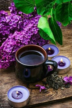 flower tea - fragrant spring flower tea on the background of burning candles and lilac bouquet Coffee Gif, Coffee Love, Coffee Break, Coffee Shop, Coffee Cups, Tea Cups, Café Chocolate, Lavender Tea, Good Morning Coffee