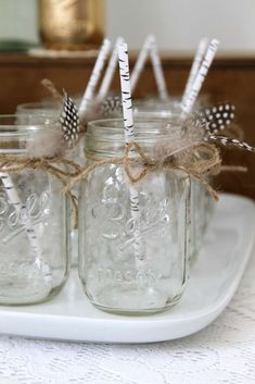 Mason jar drinks at a boho feather birthday party! See more party ideas at CatchMyParty.com!